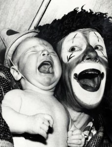 crying baby with clown